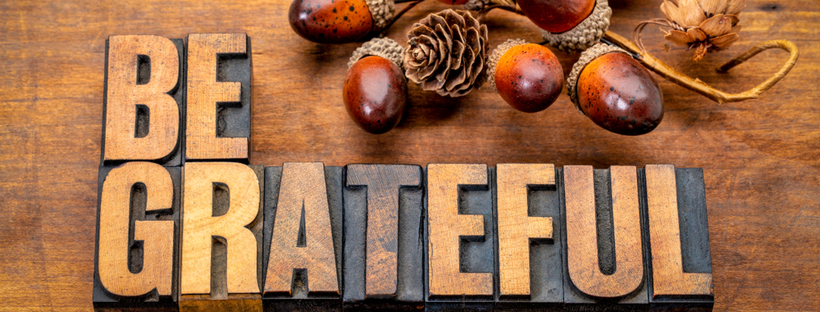 Be Grateful on a wooden background