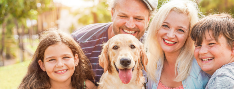 Happy Family With Their Dog